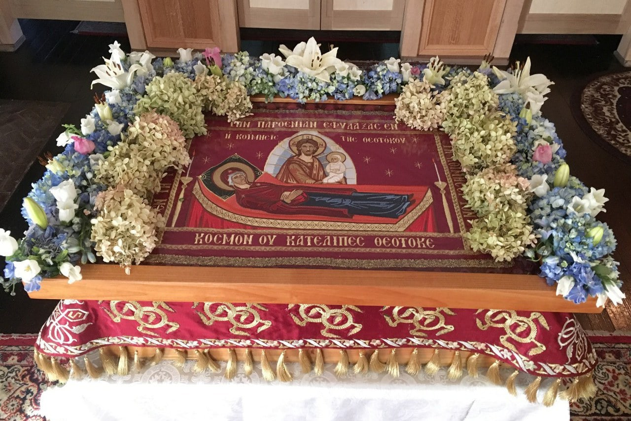 The bier of the Mother of God decorated with flowers